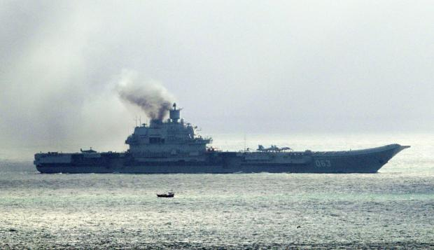HeraldScotland: The Russian aircraft carrier Admiral Kuznetsov passes through the Strait of Dover as a fleet of Russian warships sail through the North Sea on their way to reinforce the attack on the besieged city of Aleppo in Syria. PRESS ASSOCIATION Photo. Picture date