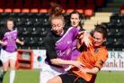 TUSSLE: Glasgow City's Abbi Grant is bundled off the ball in her side's 2-0 victory over Stirling Uni. Picture: Tommy Hughes