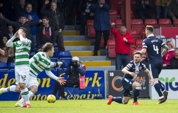 HeraldScotland: 16/04/17 LADBROKES PREMIERSHIP. ROSS COUNTY V CELTIC. GLOBAL ENERGY STADIUM - DINGWALL. Ross County's Alex Schalk (R) rises after going down in the box.