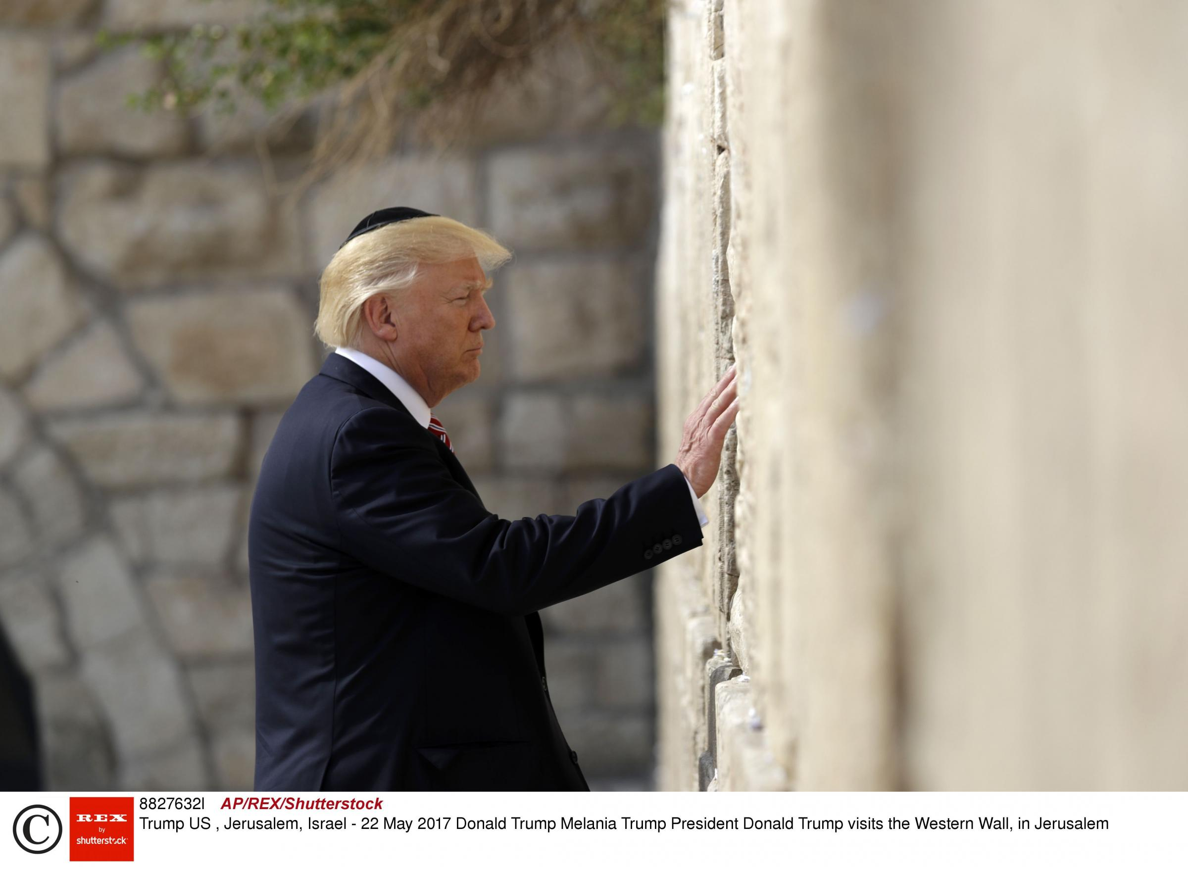 Donald Trump, pictured during an earlier visit to the Wailing Wall in Jerusalem, has declared the US recognises it as the Israeli capital.