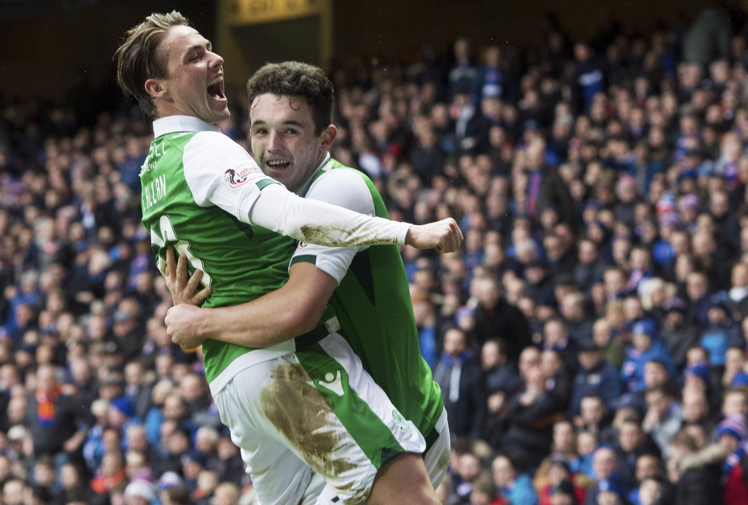 Hibernian midfielder John McGinn, right, celebrates his goal against Rangers at Ibrox on Saturday with Scott Allan.