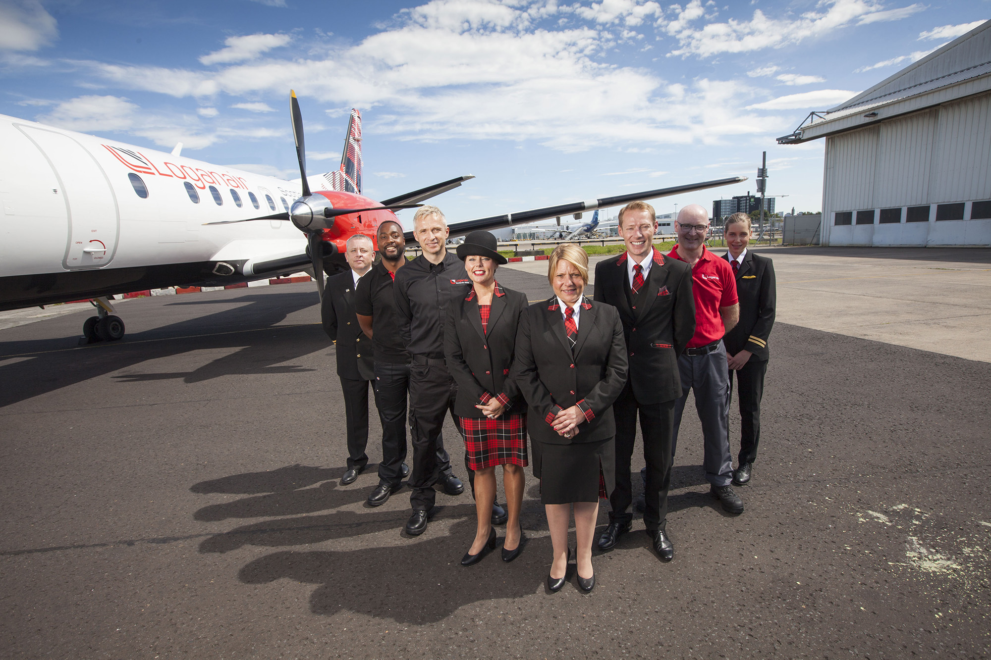 Loganair staff stand in front of one of the company's 20-stong fleet, complete with new livery