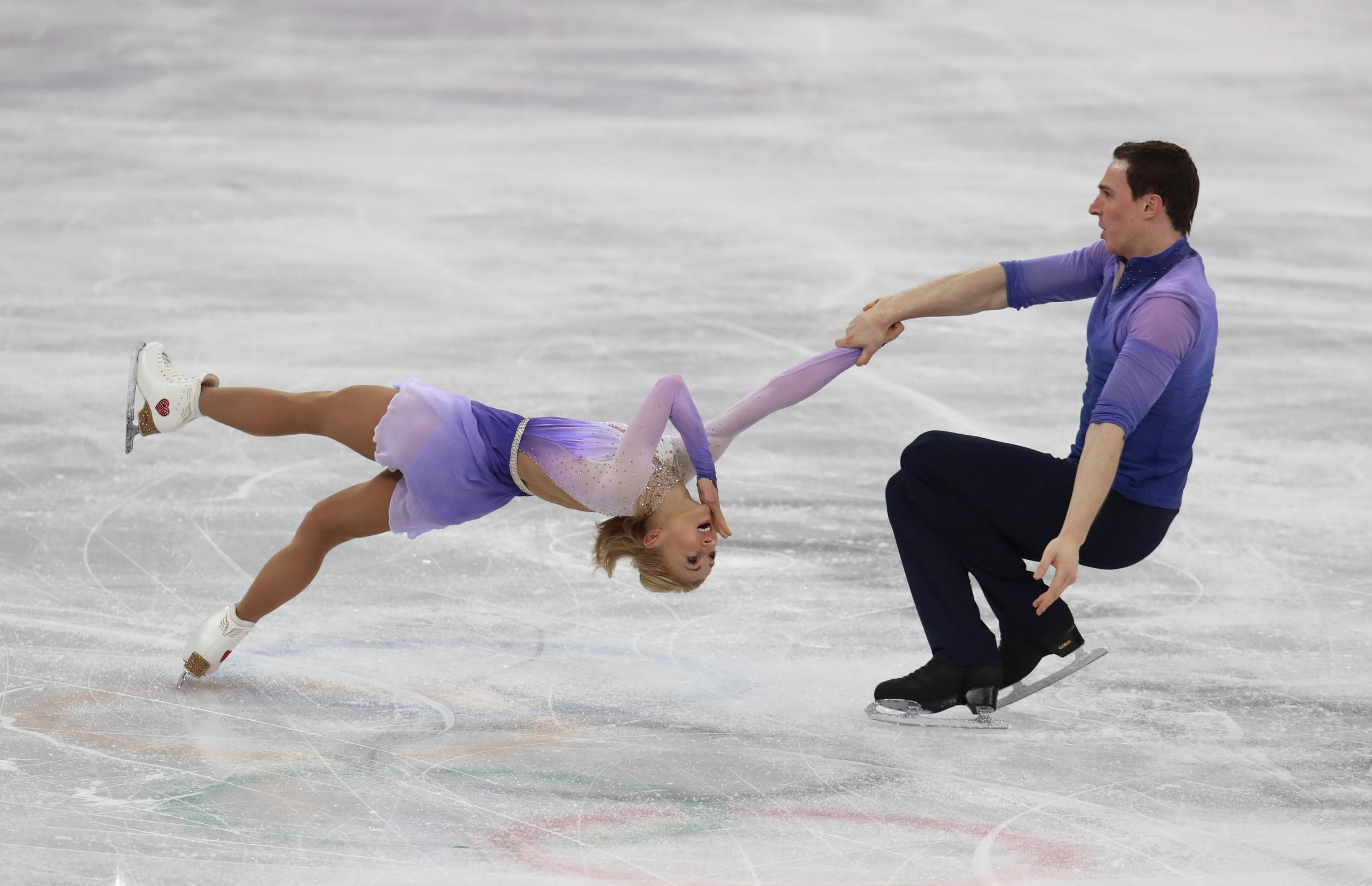 Golden couple: Bruno Massot and Aliona Savchenko turn up the heat on the ice (Picture: PA)