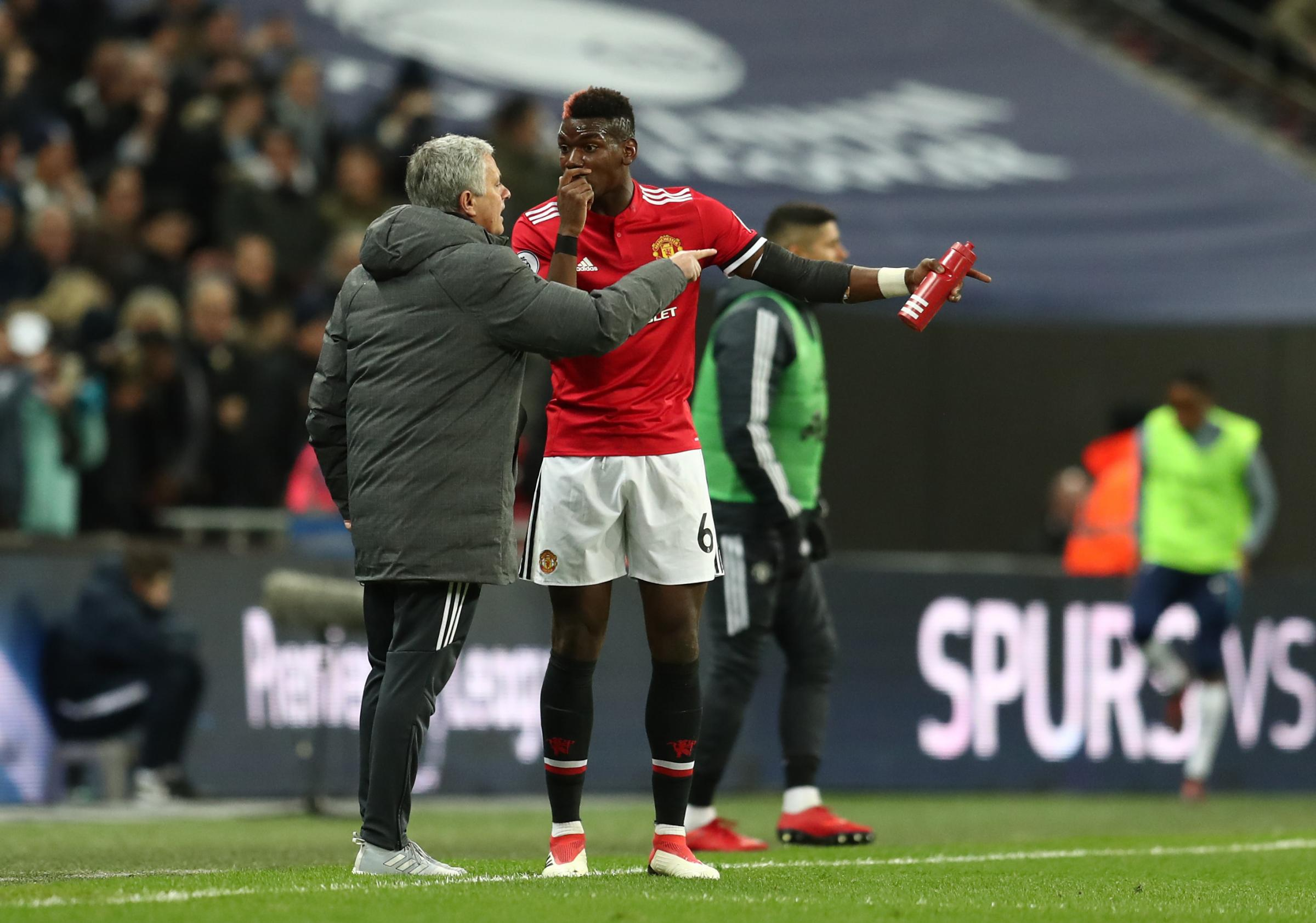 Jose Mourinho in discussion with Paul Pogba, before his substitution against Spurs Photograph: Getty