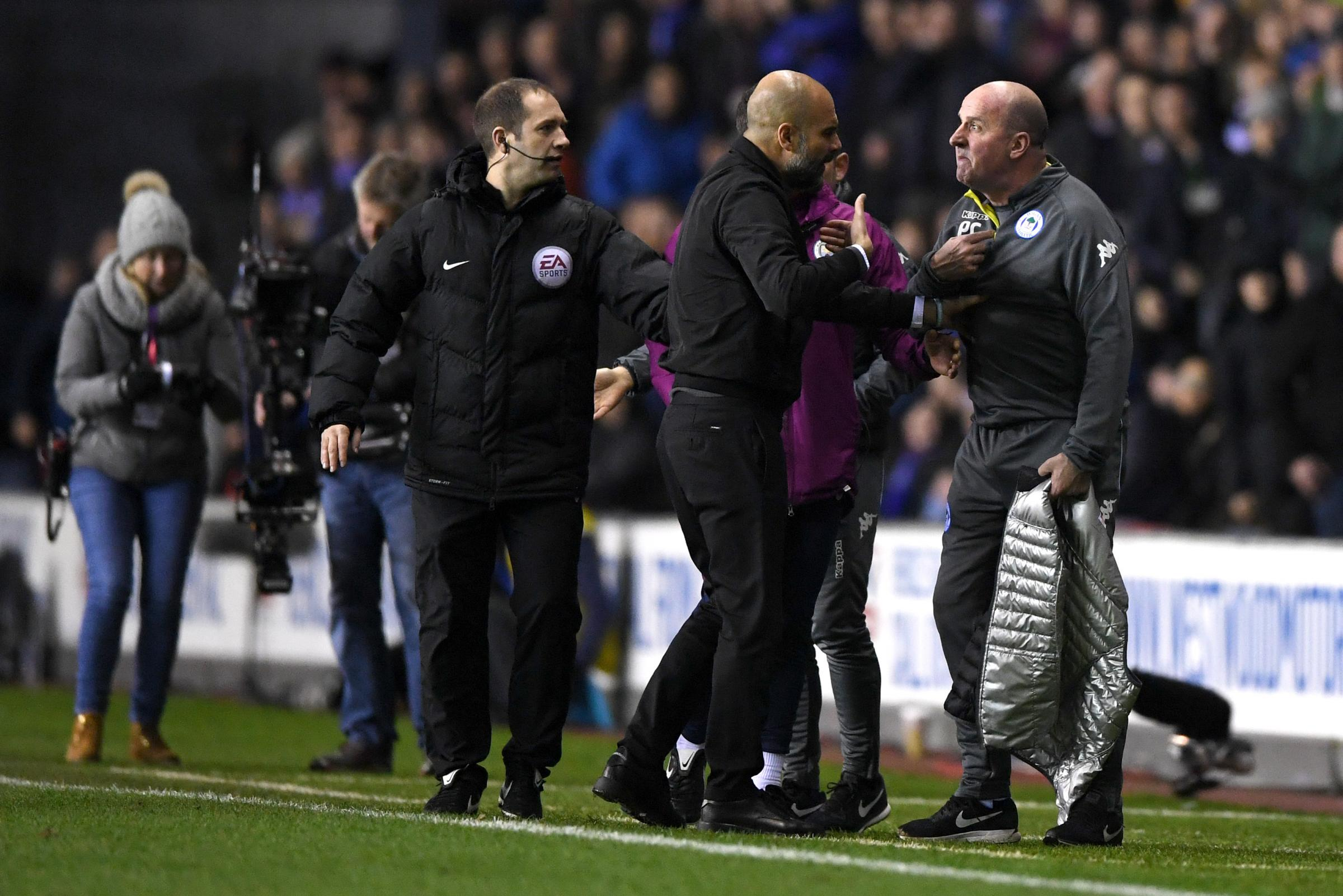 Pep Guardiola argues with Wigan manager Paul Cook during their FA Cup match last week    Photograph: Getty