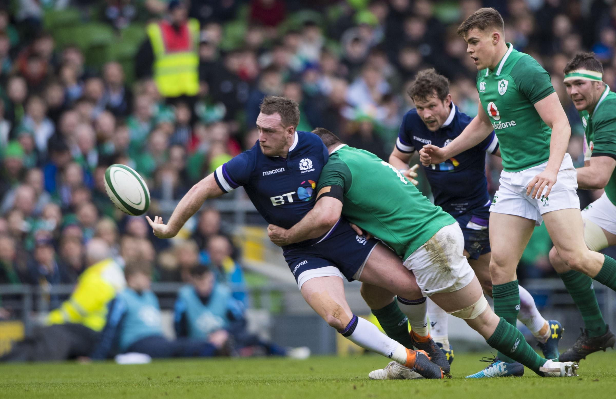 Stuart Hogg makes a superb offload but it wasn't to be his or Scotland's day