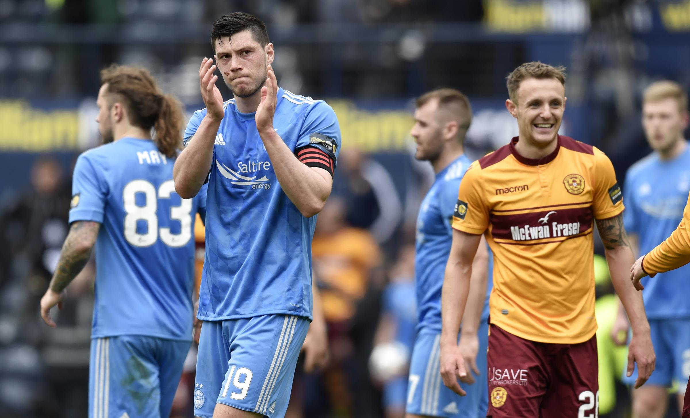 Bad day at the office: Aberdeen's Scott McKenna cuts a dejected figure at full time (Picture: SNS)