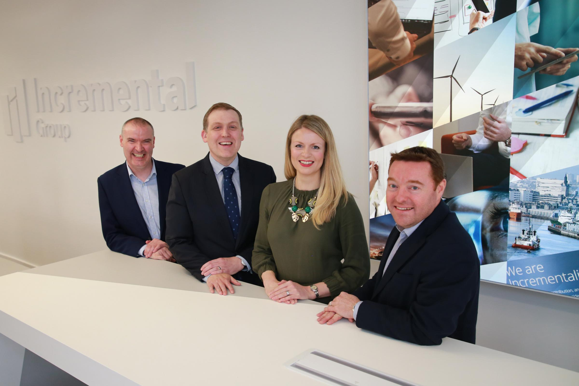 Incremental Group chief executive Neil Logan, second left, with colleagues