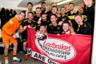 The Livingston squad celebrate in the dressing room at full-time.