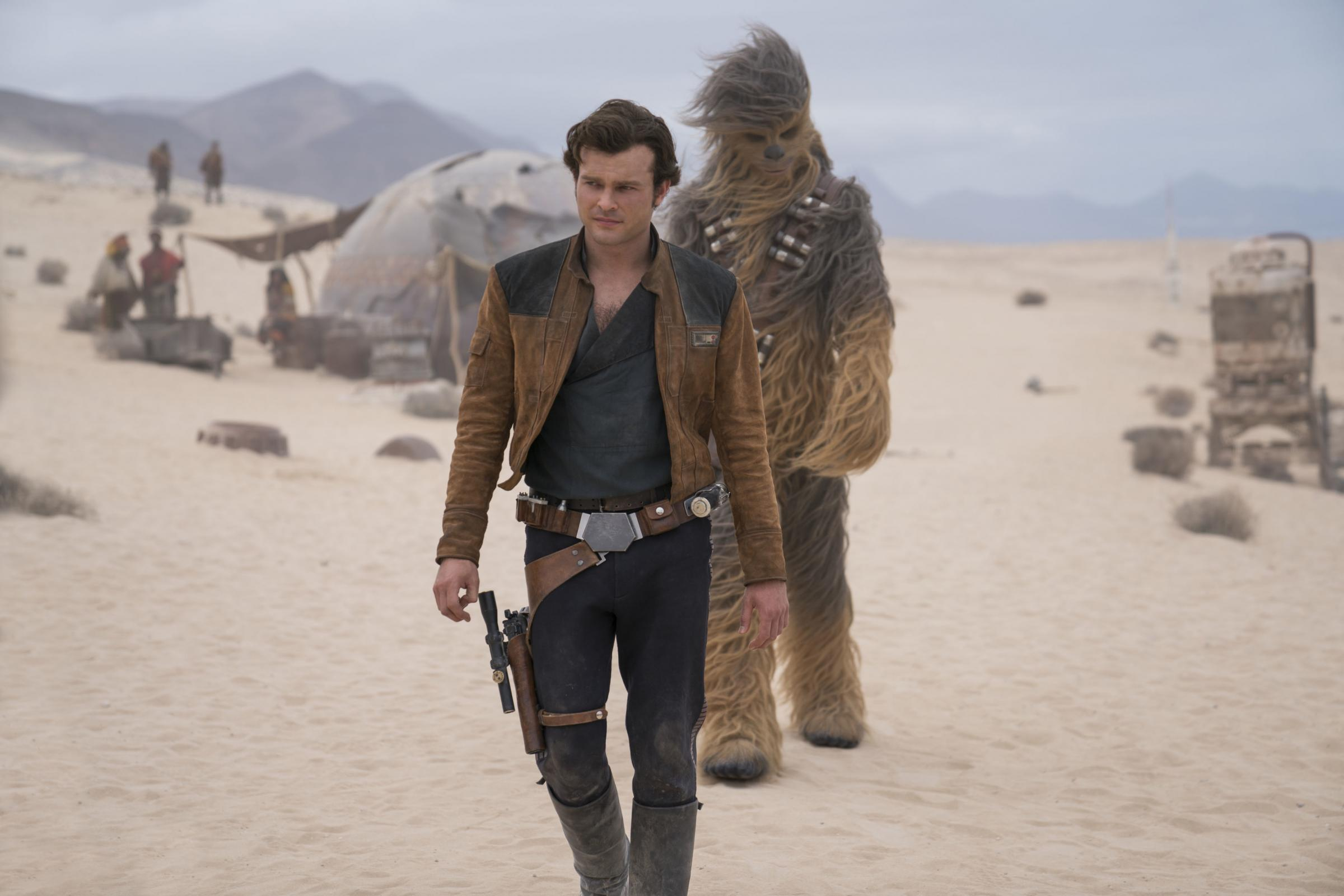 Undated film still handout from Solo: A Star Wars Story. Pictured: Alden Ehrenreich as Han Solo and Joonas Suotamo as Chewbacca. See PA Feature SHOWBIZ Film Solo. Picture credit should read: PA Photo/Lucasfilm Ltd/Jonathan Olley. WARNING: This picture mus