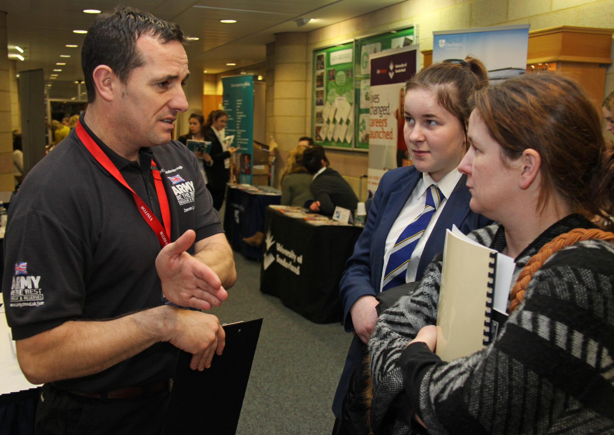 Pupils learning about the Army at a school careers fair
