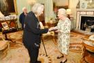 LONDON, UNITED KINGDOM - JUNE 7: Queen Elizabeth II presents the Queen's Medal for Music to the composer Thea Musgrave CBE, who was accompanied by Judith Weir (back left) Master of the Queen's Music, during an audience at Buckingham Palace on June