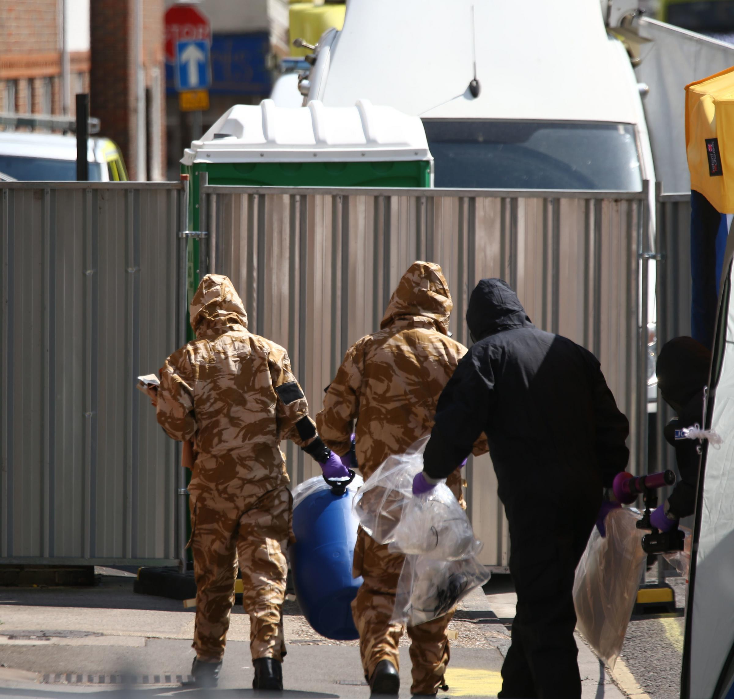 Investigators in chemical suits work behind screens erected in Rollestone Street, Salisbury, Wiltshire, where counter-terrorism officers are investigating after a couple were left in a critical condition when they were exposed to the nerve agent Novichok.
