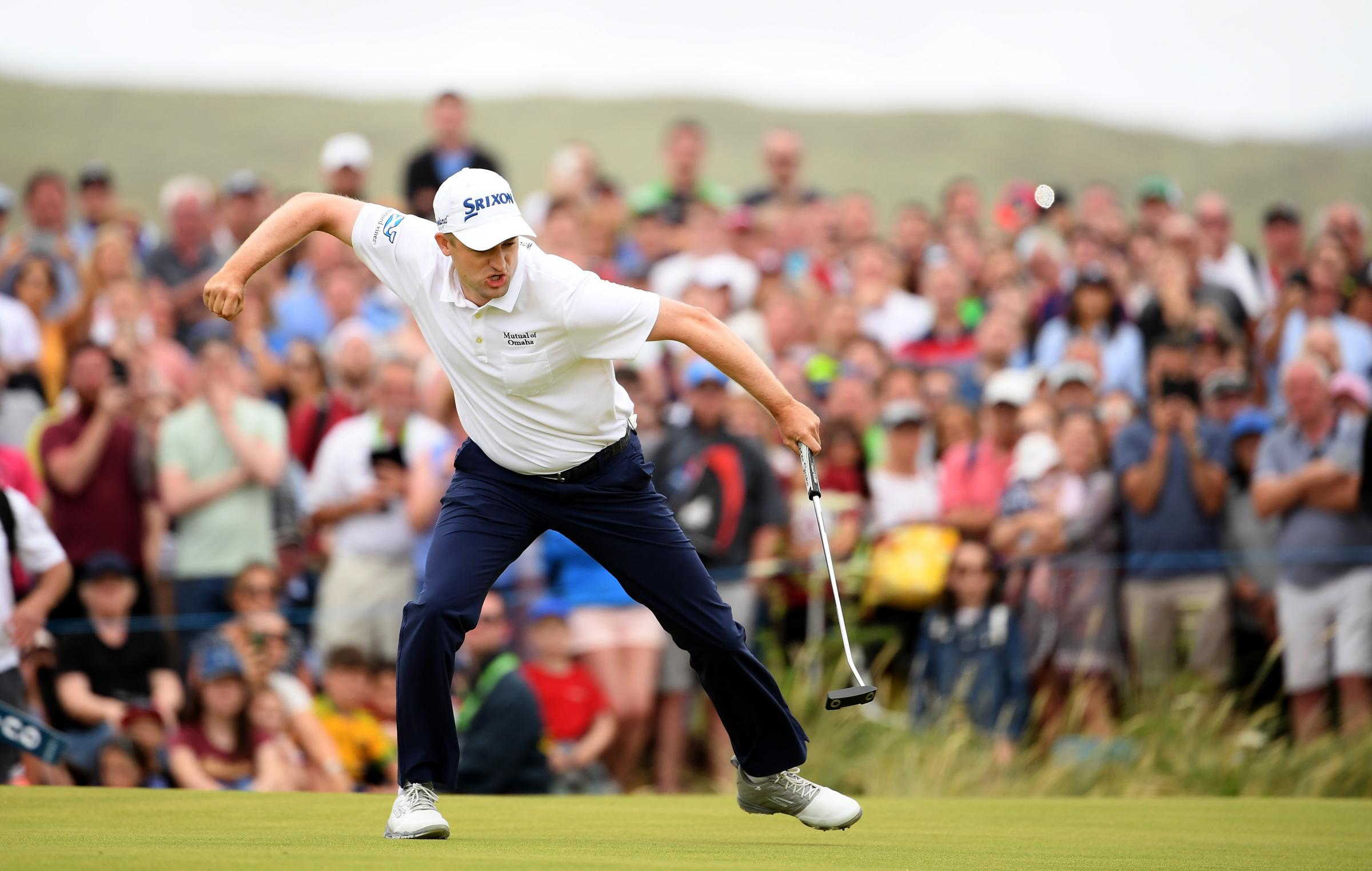 Get in there: Russell Knox shows his delight at winning the Irish Open (Picture: Getty)