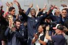 The crowd gathers on the Champs-Elysees avenue to welcome the French soccer team for a parade a day after the French team victory in the soccer World Cup, in Paris, Monday, July 16, 2018. France is readying to welcome home the national soccer team for a p