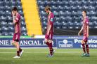 St Johnstone players, left to right, Scott Tanser, Murray Davidson and Stefan Scougall, leave Rugby Park dejected after a 2-0 defeat   Photograph: SNS