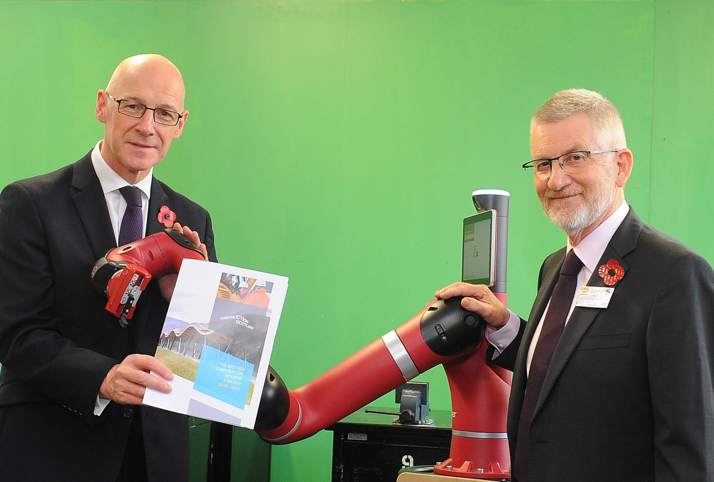 John Swinney MSP and Ron Fraser, Construction Scotland's interim executive director, with Sawyer the collaborative robot
