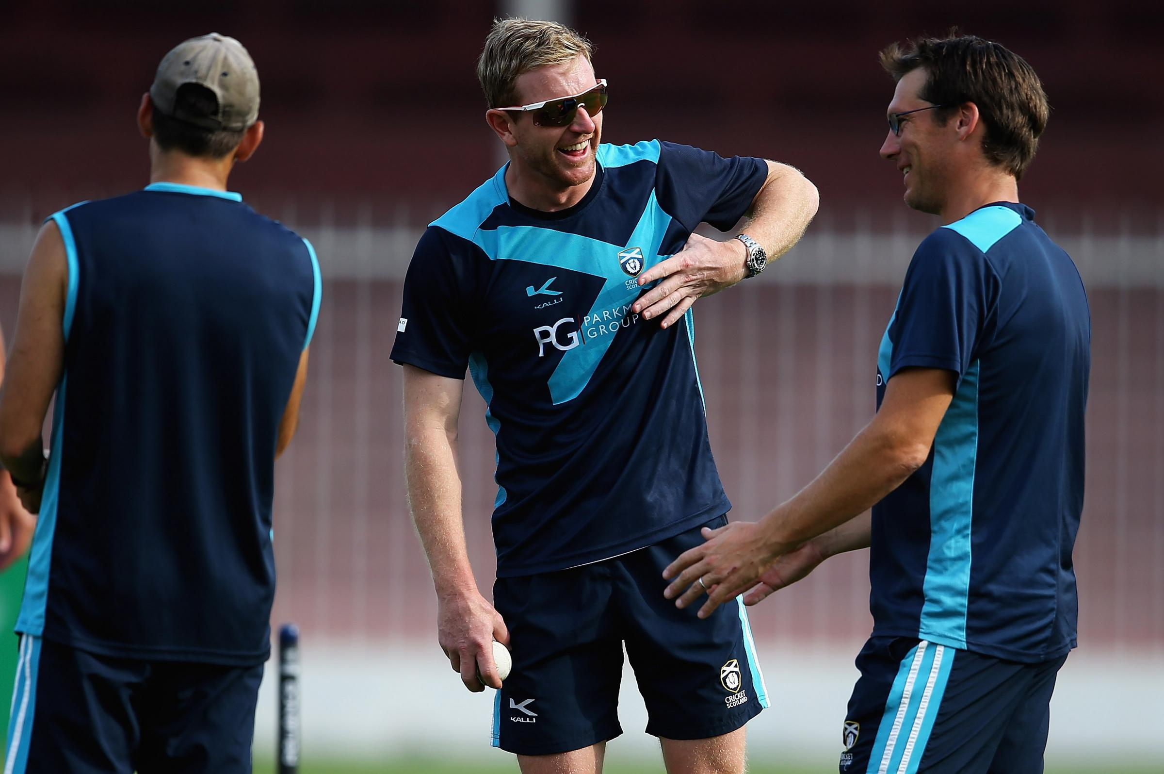 Paul Collingwood, part of the coaching staff with Scotland talks to Peter Steindl (L) and Toby Bailey ahead of the ICC World Twenty20 Qualifier match between Scotland and Bermuda at Sharjah Cricket Stadium on November 15, 2013 in Sharjah, United Arab Emi