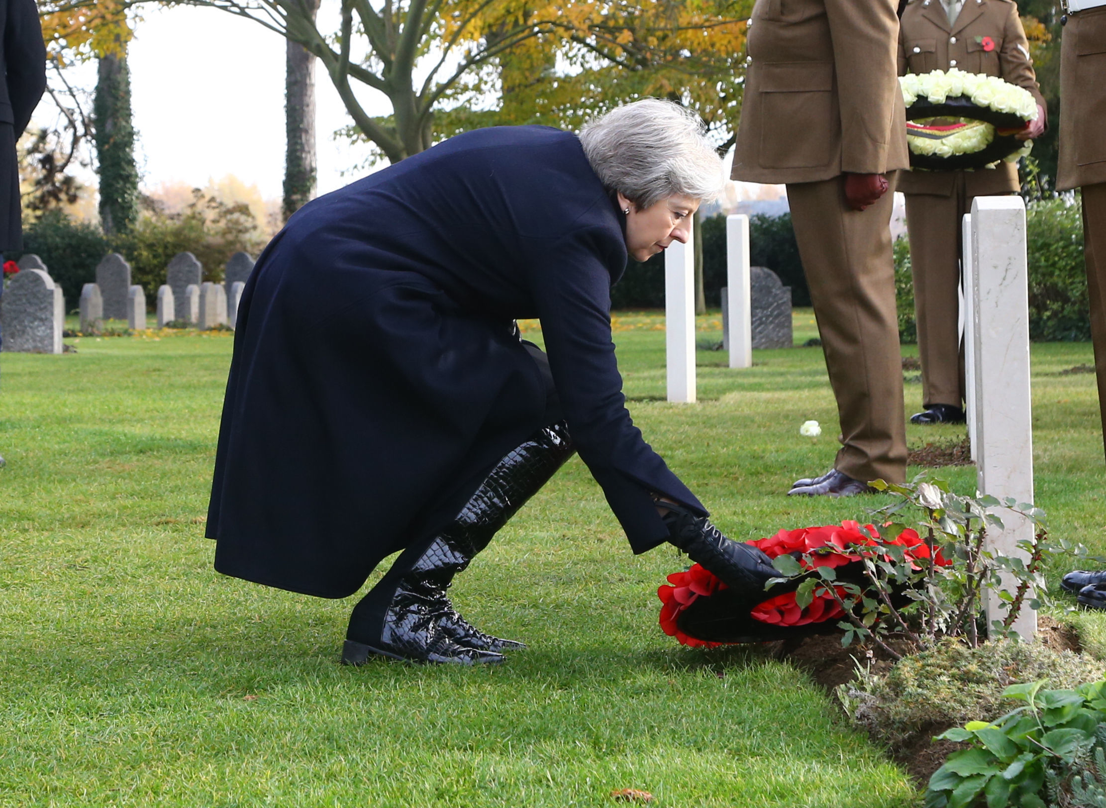 Theresa May lays wreath in Belgium (Photo: PA)