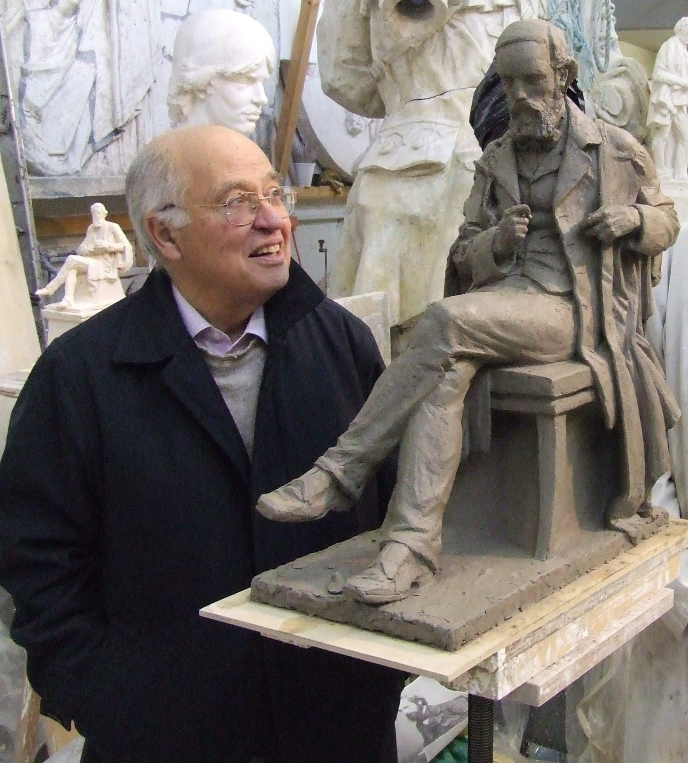Sir Michael Atiyah with a model of the statue of James Clerk Maxwell