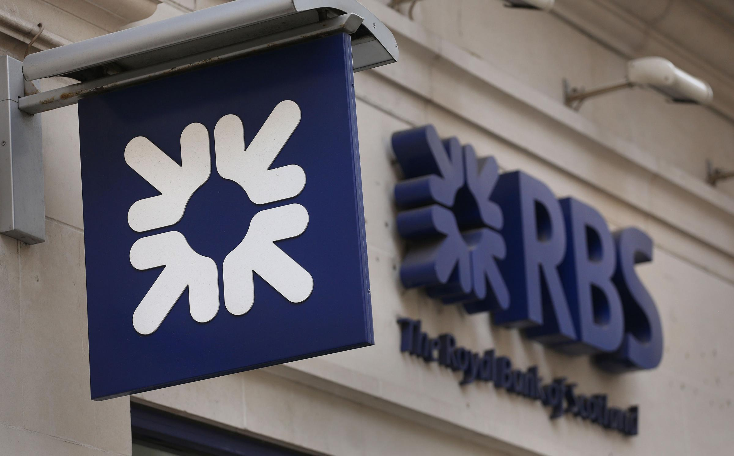 File photo dated 03/04/13 of an RBS sign. Royal Bank of Scotland shareholders have approved a proposal that allows the lender to buy back up to £1.5 billion worth of shares from the Government, as it looks to deploy excess capital and speed u
